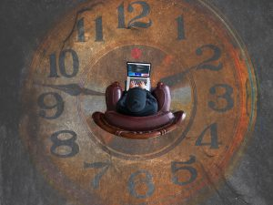 laptop work with big clock on the floor